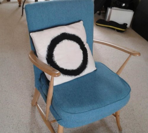 Blue chair with cushion